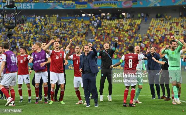 Franco Foda, Head Coach of Austria and players of Austria celebrate their side's victory after the UEFA Euro 2020 Championship Group C match between...