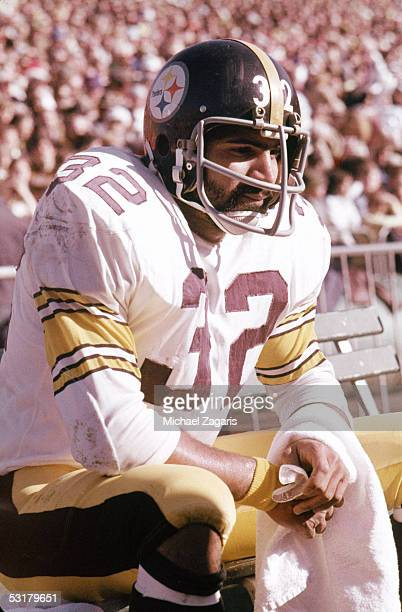 Franco Harris of the Pittsburgh Steelers rests on the sidelines during the AFC Championship game against the Oakland Raiders at the Oakland Alameda...