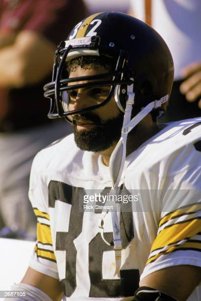 Franco Harris of the Pittsburgh Steelers sits on the sideline during a 1983 NFL season game