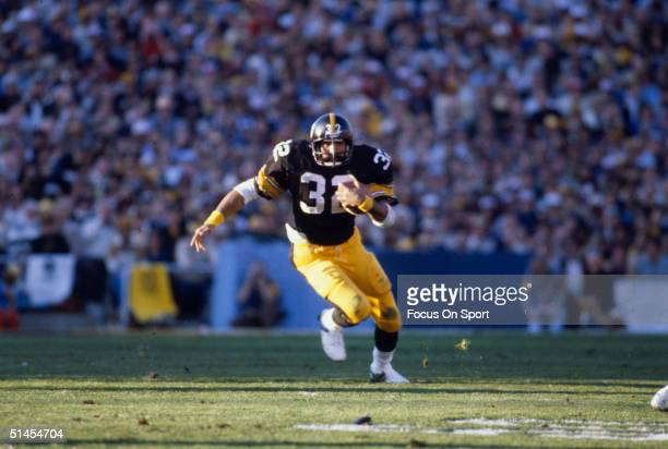 Franco Harris running back for the Pittsburgh Steelers runs with the ball during Super Bowl XIV against the Los Angeles Rams at the Rose Bowl on...