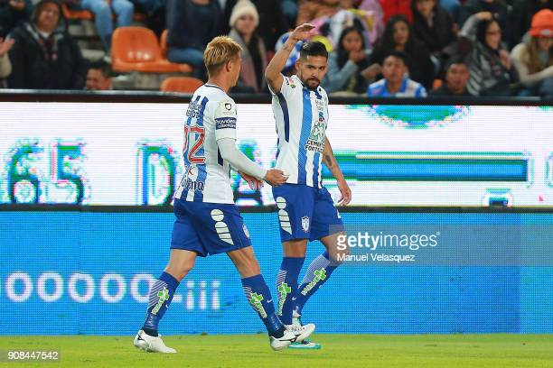 Franco Jara and Keisuke Honda of Pachuca celebrate their team's second goal during the 3rd round match between Pachuca and Lobos BUAP as part of the...