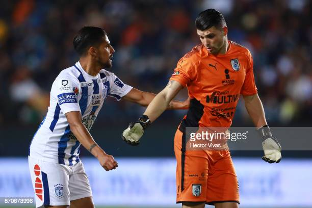 Franco Jara of Pachuca argues with Tiago Volpi of Queretaro during the 16th round match between Pachuca and Queretaro as part of the Torneo Apertura...