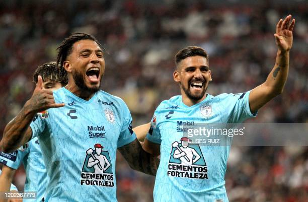 Franco Jara of Pachuca celebrates his goal against Atlas with teammate Colin KazimRichards during their Mexican Clausura 2020 tournament football...