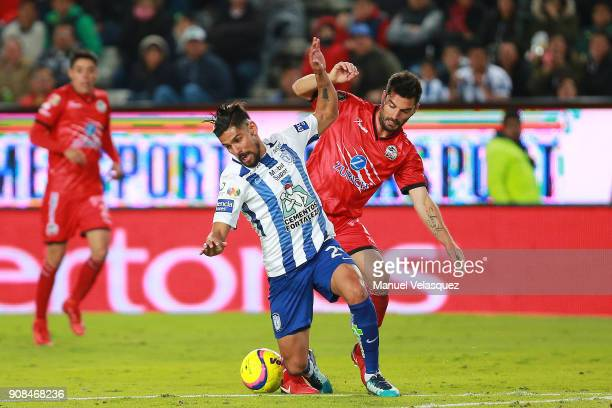 Franco Jara of Pachuca struggles for the ball against Facundo Erpen of Lobos BUAP during the 3rd round match between Pachuca and Lobos BUAP as part...