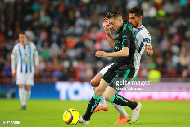 Franco Jara of Pachuca struggles for the ball against Jorge Flores of Santos during the 15th round match between Pachuca and Santos Laguna as part of...