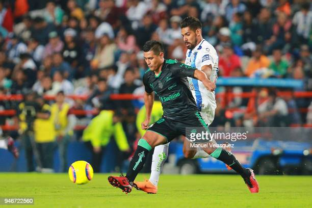 Franco Jara of Pachuca struggles for the ball against Osvaldo Martinez of Santos during the 15th round match between Pachuca and Santos Laguna as...