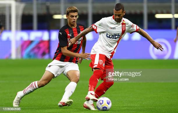 Franco Lepore of Monza competes for the ball with Daniel Maldini of AC Milan during the pre-season friendly match between AC Milan and Monza at...