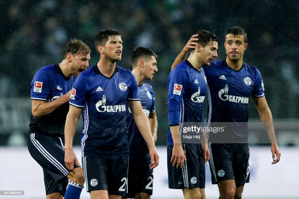 Franco Matias Di Santo (R), Leon Goretzka (2R) and Klaas-Jan Huntelaar (2L) of Schalke react after the Bundesliga match between Borussia Moenchengladbach and FC Schalke 04 at Borussia-Park on March 4, 2017 in Moenchengladbach, Germany.