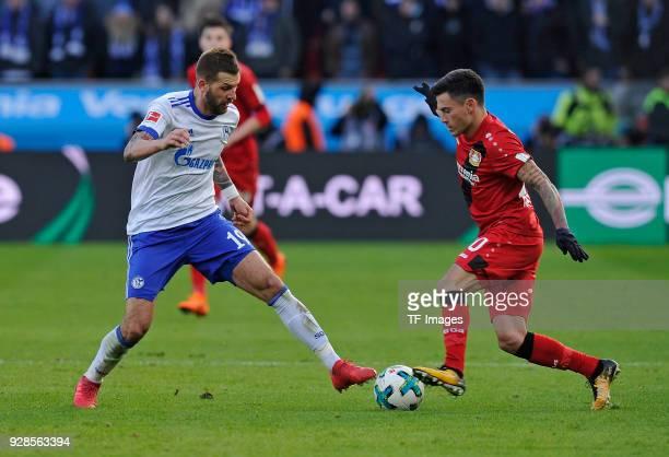 Franco Matias Di Santo of Schalke and Charles Aranguiz of Leverkusen battle for the ball during the Bundesliga match between Bayer 04 Leverkusen and...