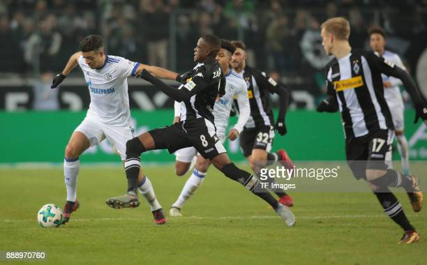 Franco Matias Di Santo of Schalke and Denis Zakaria of Borussia Moenchengladbach battle for the ball during the Bundesliga match between Borussia...