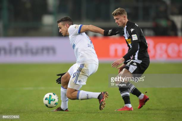 Franco Matias Di Santo of Schalke and Mickael Cuisance of Moenchengladbach battle for the ball during the Bundesliga match between Borussia...