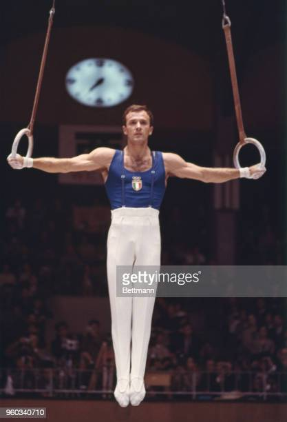 Franco Menichelli of Italy during the Men's Flying Rings event in the gymnastics finals. He placed second and won the silver medal.