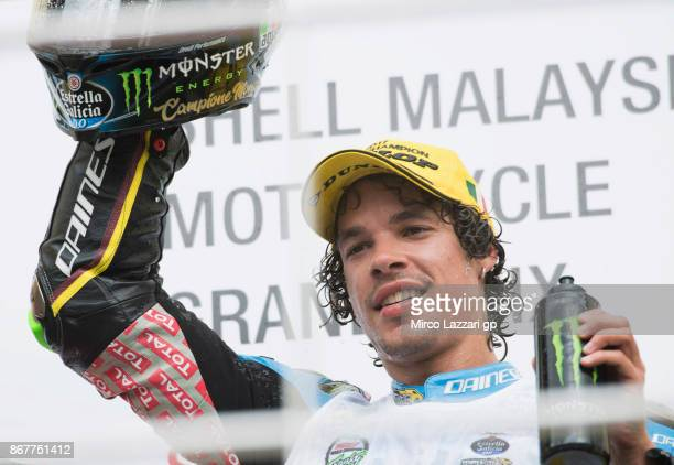 Franco Morbidelli of Italy and EG 00 Marc VDS celebrates on the podium the third place of the Moto2 race and the victory of the Moto2 World...