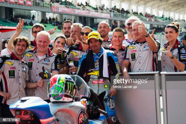 Franco Morbidelli of Italy and EG 00 Marc VDS celebrates the Moto2 pole position with team at the end of the qualifying practice during the MotoGP Of...