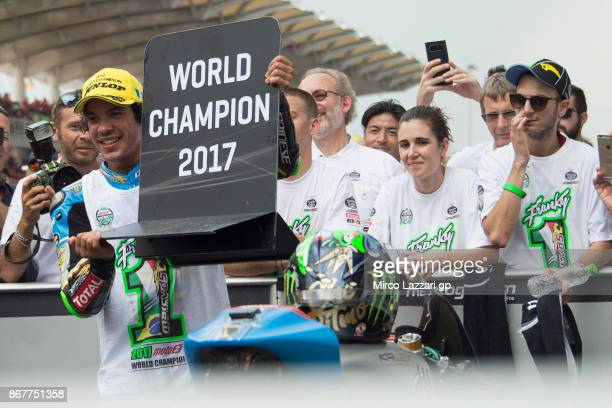Franco Morbidelli of Italy and EG 00 Marc VDS celebrates under the podium the third place of the Moto2 race and the victory of the Moto2 World...