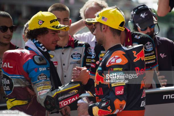 Franco Morbidelli of Italy and EG 00 Marc VDS celebrates with Miguel Oliveira of Portugal and Red Bull KTM Ajo at the end of the Moto2 qualifying...