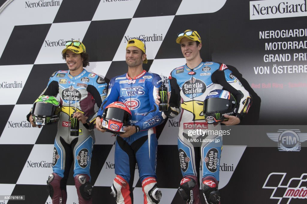 Franco Morbidelli of Italy and EG 00 Marc VDS, Mattia Pasini of Italy and Italtrans Racing Team and Alex Marquez of Spain and EG 00 Marc VDS celebrate at the end of the qualifying practice during the MotoGp of Austria - Qualifying at Red Bull Ring on August 12, 2017 in Spielberg, Austria.