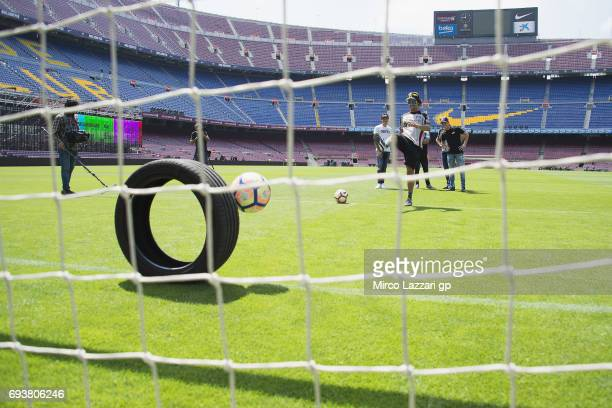 Franco Morbidelli of Italy and EG 00 Marc VDS plays football during the preevent 'FC Barcelona meets MotoGP' at FC Barcelona's Camp Nou to celebrate...