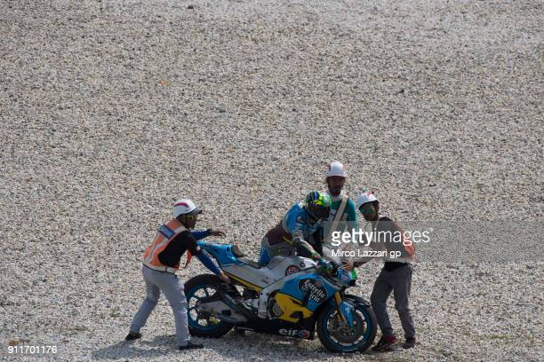 Franco Morbidelli of Italy and EG 00 Marc VDS walks out of track with marshall staff during the MotoGP Tests In Sepang at Sepang Circuit on January...