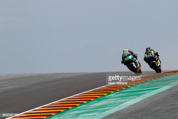 Franco Morbidelli of Italy and Hector Garzo of Spain ride in qualifying during the MotoGP of Germany at Sachsenring Circuit on July 1 2017 in...