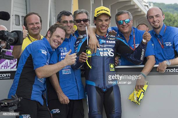 Franco Morbidelli of Italy and Italtrans Racing Team celebrates the third place with team during the MotoGp of Germany Qualifying at Sachsenring...