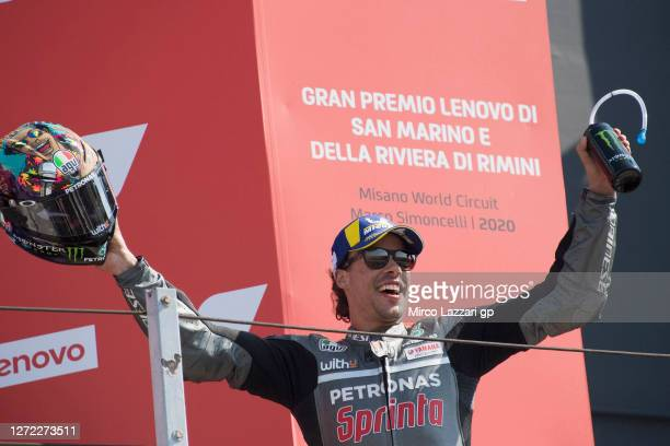 Franco Morbidelli of Italy and Petronas Yamaha SRT smiles and celebrates his first MotoGP victory on the podium at the end of the MotoGP race during...