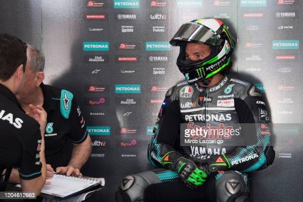 Franco Morbidelli of Italy and Petronas Yamaha SRT speaks in box with mechanic during the MotoGP PreSeason Tests at Sepang Circuit on February 07...