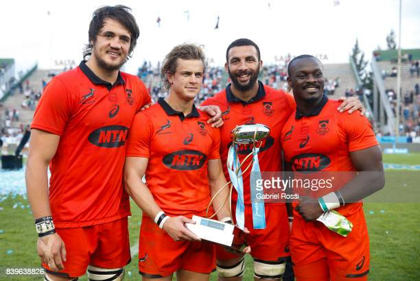 Franco Mostert Andries Coetzee Uzair Cassiem and Raymond Rhule pose with the trophy after winning the round two match between Argentina and South...
