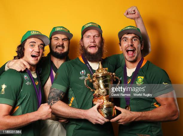 Franco Mostert Lodewyk de Jager RG Snyman and Eben Etzebeth of South Africa pose for a photo with the Web Ellis cup following their team's victory...