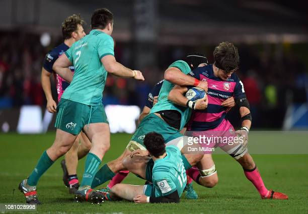 Franco Mostert of Gloucester is tackled by Joey Carbery and CJ Stander of Munster during the Champions Cup match between Gloucester Rugby and Munster...