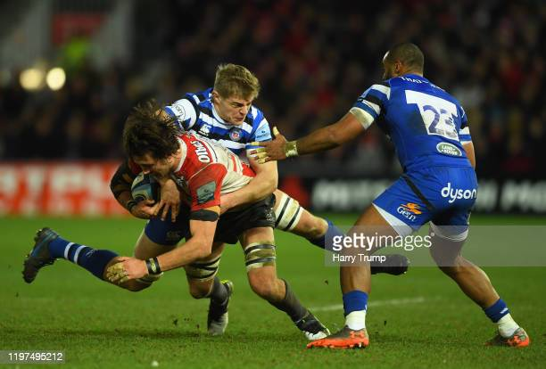 Franco Mostert of Gloucester Rugby is tackled by Jack Walker of Bath Rugby and Aled Brew of Bath Rugby during the Gallagher Premiership Rugby match...