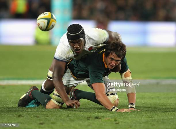 Franco Mostert of South Africa is tackled by Maro Itoje during the first test match between South Africa and England at Elllis Park on June 9 2018 in...
