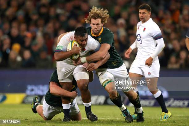 Franco Mostert of South Africa tackles Mako Vunipola of England during the second test match between South Africa and England on June 16 2018 in...