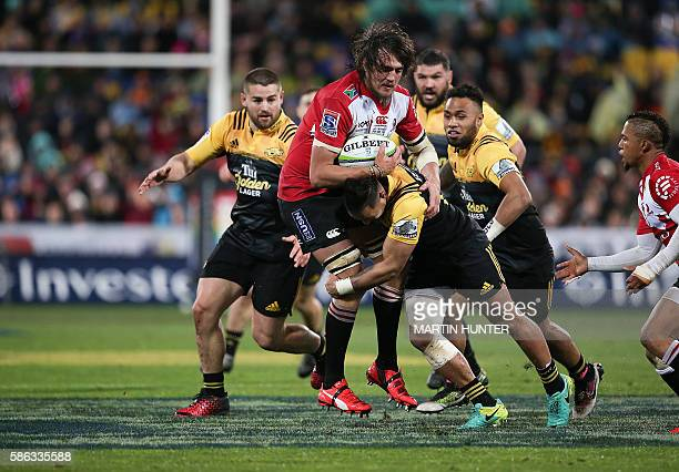 Franco Mostert of the Lions is tackled during the Super Rugby final match between the Wellington Hurricanes and Lions of South Africa at Westpac...