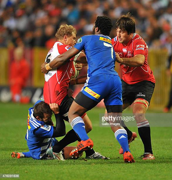 Franco Mostert of the Lions tackled by Siya Kolisi of the Stormers during the Super Rugby match between DHL Stormers and Emirates Lions at DHL...