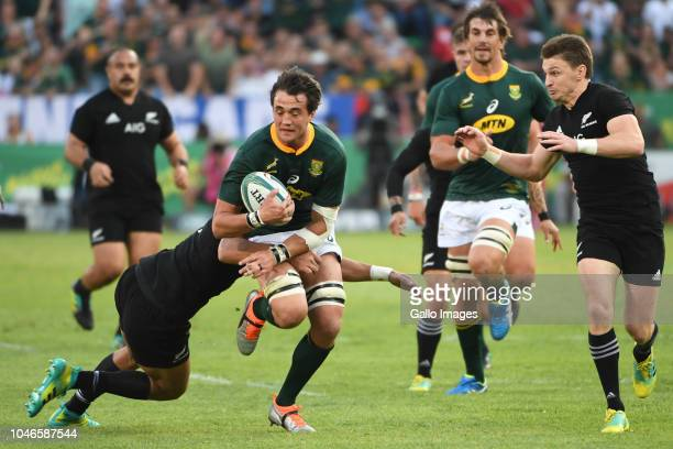 Franco Mostert of the Springboks tackled by Rieko Ioane of New Zealand during the Rugby Championship match between South Africa and New Zealand at...
