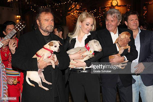 Franco Nero Alain Delon with dog and Kathrin Glock with lamb Francis Fulton Smith during the Opening of the Gut Aiderbichl Christmas Market on...