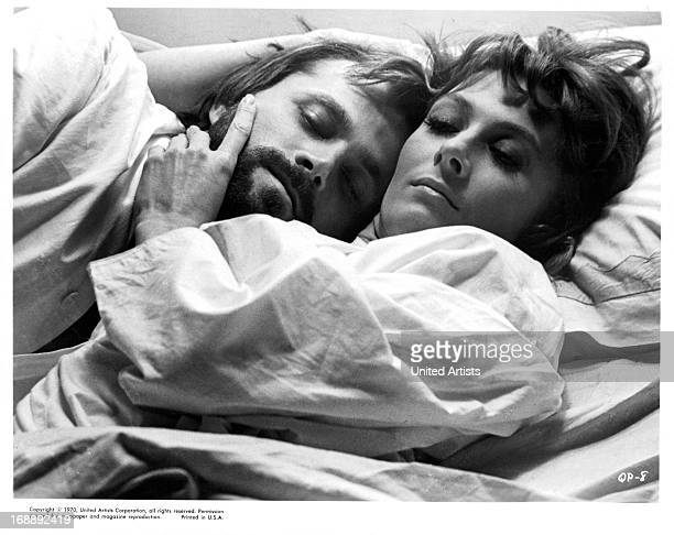 Franco Nero lies with Vanessa Redgrave in a scene from the film 'A Quiet Place In The Country' 1968