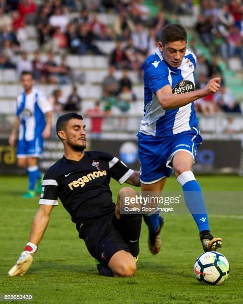 Franco Paron of Racing de Ferrol competes for the ball with Federico Valverde of Deportivo de la Coruna during the preseason friendly match between...