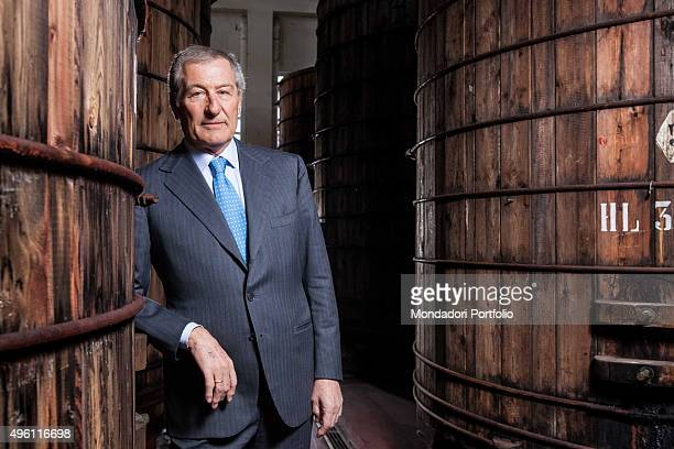 Franco Ponti chief executive officer of the Italian vinegar company of the same name posing for a photo shooting among the barrels of a cellar Italy...