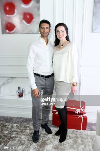 Franco Rivera and Julia Foster attend Roric Tobin's Holiday Dining Room For Luxury Living at Luxury Living Showroom on December 11 2019 in New York...
