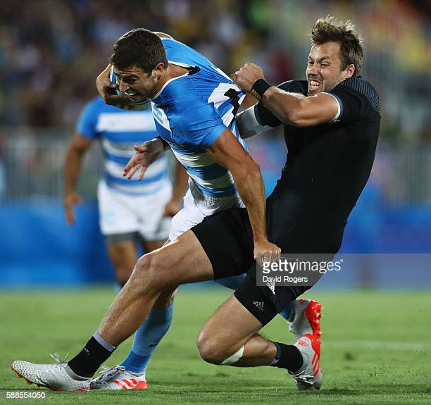Franco Sabato of Argentina is tackled by Tim Mikkelson of New Zealand during the Men's Rugby Sevens placing 56 match between New Zealand and...