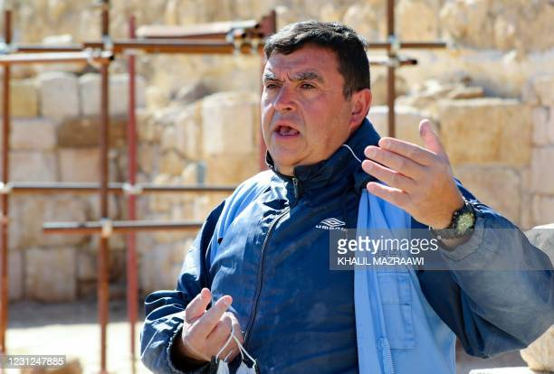 Franco Sciorilli, an Italian expert, speaks to AFP as he supervises workers employed by a pilot project run by the UN cultural agency UNESCO, to...
