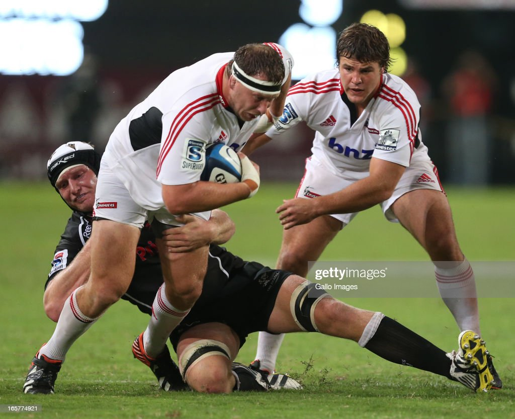 Franco van der Merwe of Sharks tackles Wyatt Crockett of Crusaders during the Super Rugby match between The Sharks and Crusaders from Kings Park on April 05, 2013 in Durban, South Africa.