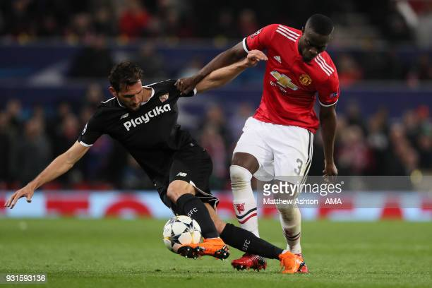 Franco Vanquez of Sevilla and Eric Bailly of Manchester United during the UEFA Champions League Round of 16 Second Leg match between Manchester...