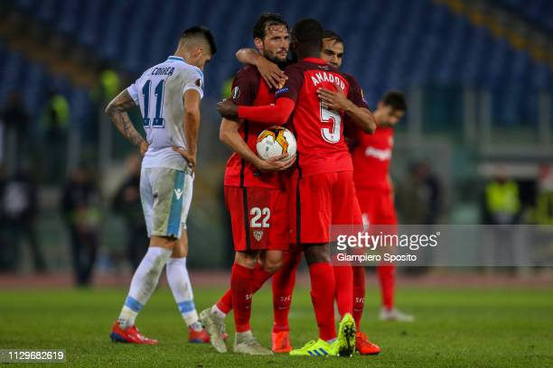 Franco Vazquez Ibrahim Amadou and Gabriel Mercado of Sevilla celebrate after defeating SS Lazio in the UEFA Europa League Round of 32 First Leg match...