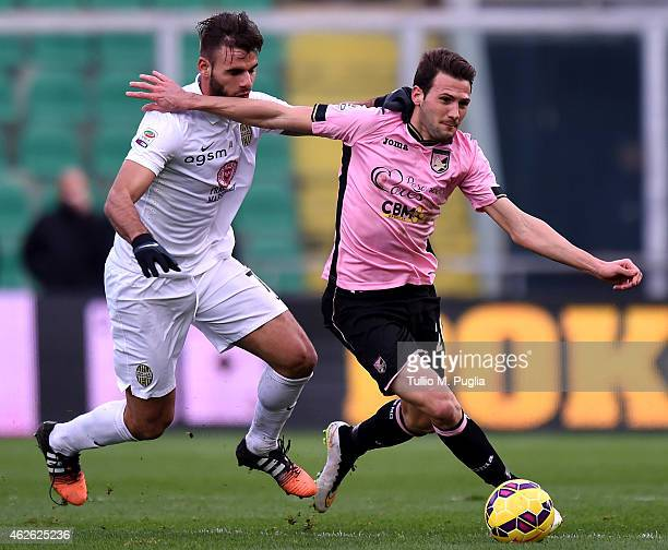 Franco Vazquez of Palermo and Panagiotis Tachtsidis of Hellas Verona compete for the ball during the Serie A match between US Citta di Palermo and...