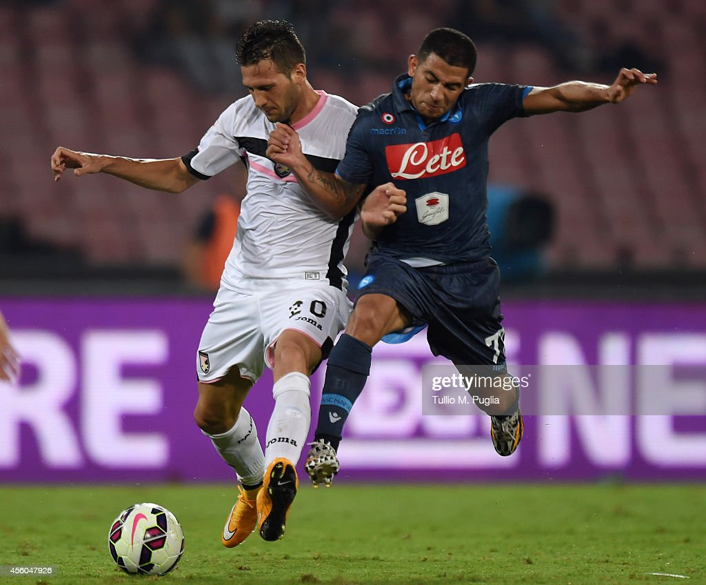 Franco Vazquez (L) of Palermo and Walter Gargano of Napoli compete for the ball during the Serie A match between SSC Napoli and US Citta di Palermo at Stadio San Paolo on September 24, 2014 in Naples, Italy.