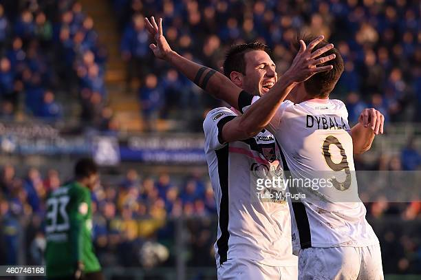 Franco Vazquez of Palermo celebrates with Paulo Dybala after scoring his team's third goal during the Serie A match betweeen Atalanta BC and US Citta...
