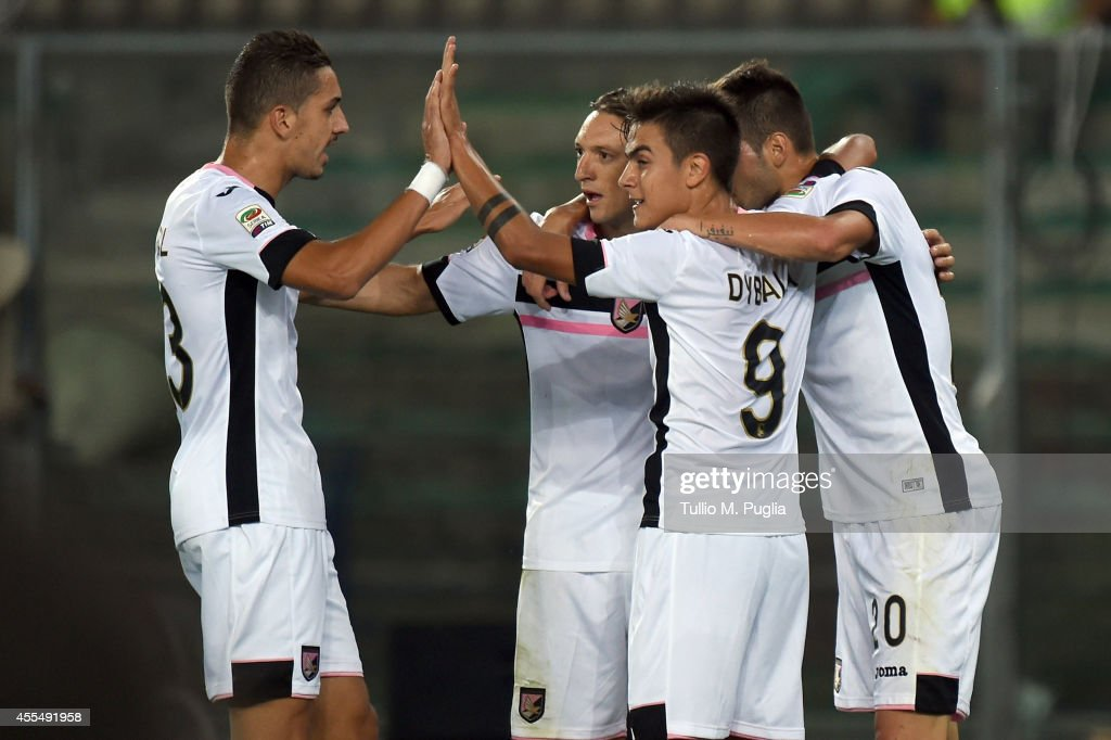 Franco Vazquez of Palermo celebrates with team mates after scoring the opening goal during the Serie A match between Hellas Verona FC and US Citta di Palermo at Stadio Marc'Antonio Bentegodi on September 15, 2014 in Verona, Italy.